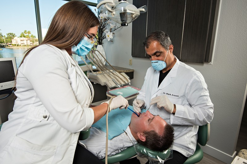 emergency treatment at mark arooni dds