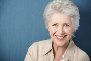 Beautiful elegant elderly lady with a lively smile. Chandler, AZ dentist provides dental implant.